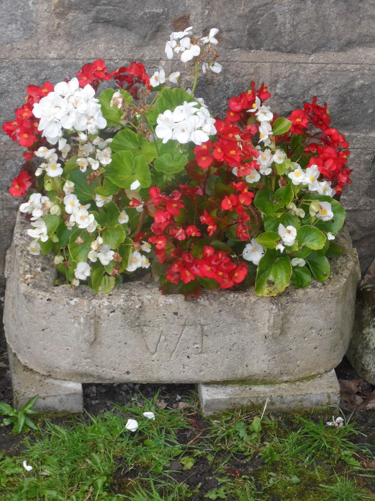 Stone basket of flowers