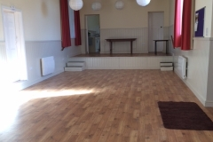 Main hall with new floor, heating, lighting and stage at far end